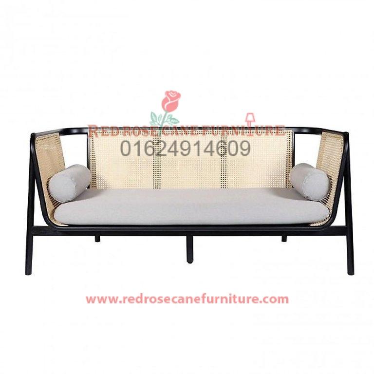 Cane and wood mixed sofa